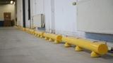 Kunststof doorrijbeveiliging ø100 mm. -1500mm.x155mm. brede voetplaat